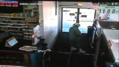 VIDEO: Truck Crashes Into Store, Pinning Woman Buying Lotto Tickets to the Wall