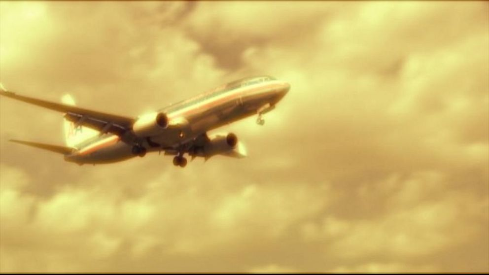 VIDEO: Passengers describe a traumatic emergency landing after hearing a loud boom.