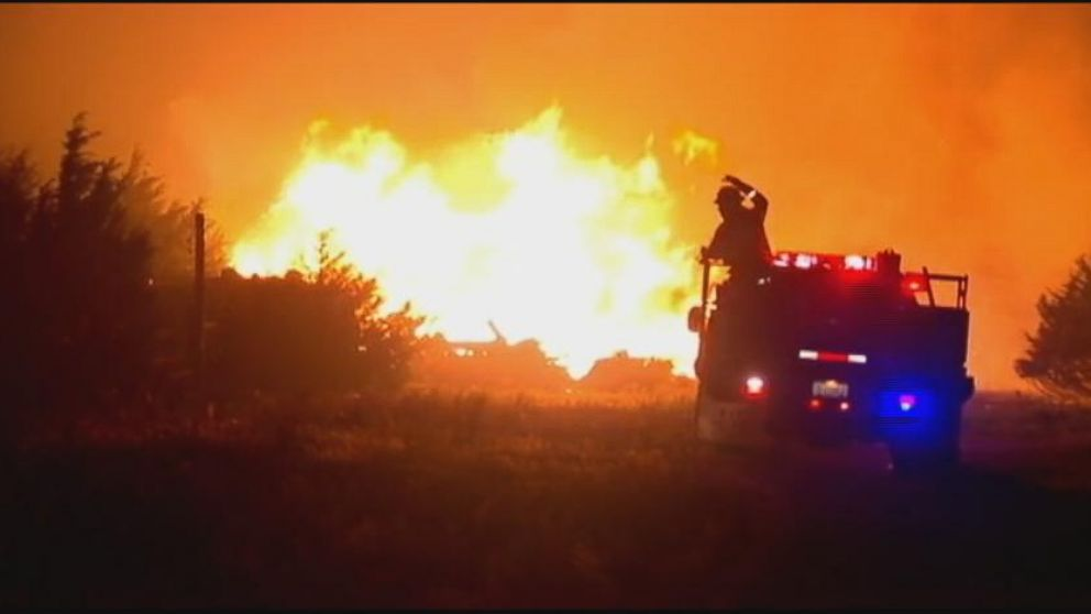 VIDEO: Gusting winds sparked flames that have put hundreds of homes in jeopardy in city of Guthrie.