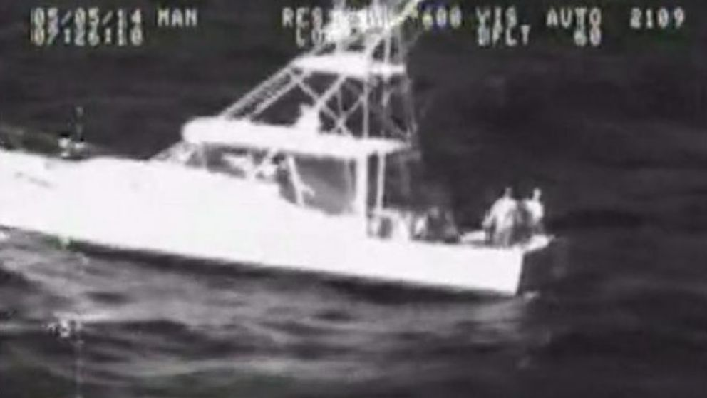 VIDEO: The two men clung to their boat after it was capsized by a rogue wave.