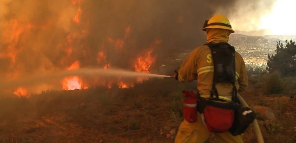 VIDEO: Firefighters battle the blazes overnight as 23,000 evacuation notices have been issued.