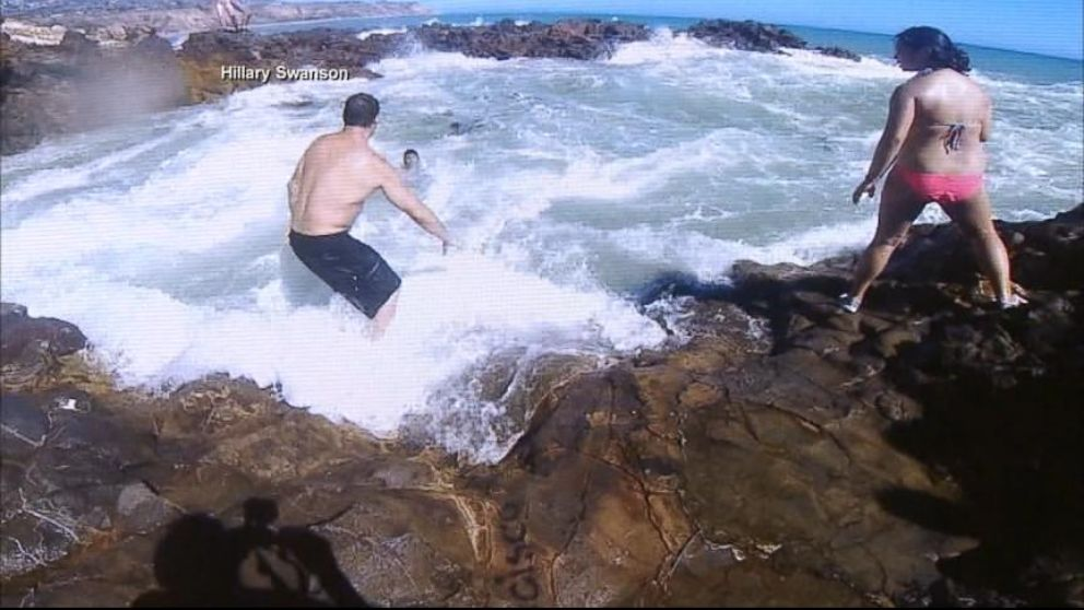 VIDEO: When Gary Golding and Rob McNulty saw a teen trapped in a rip current, they dove into action.