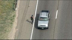 VIDEO: A man armed with a rifle and a handgun carjacked two people on a highway west of Denver.