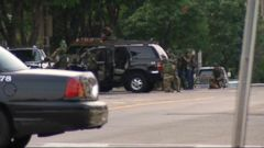 VIDEO: Police apprehend alleged cop killer after exchanging fire on the streets of St. Paul.
