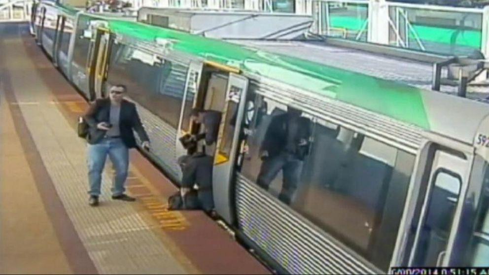 Between Man Man Gets Stuck Between a Train