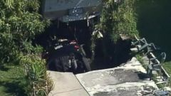 VIDEO: Car Falls Into Expanding Sinkhole