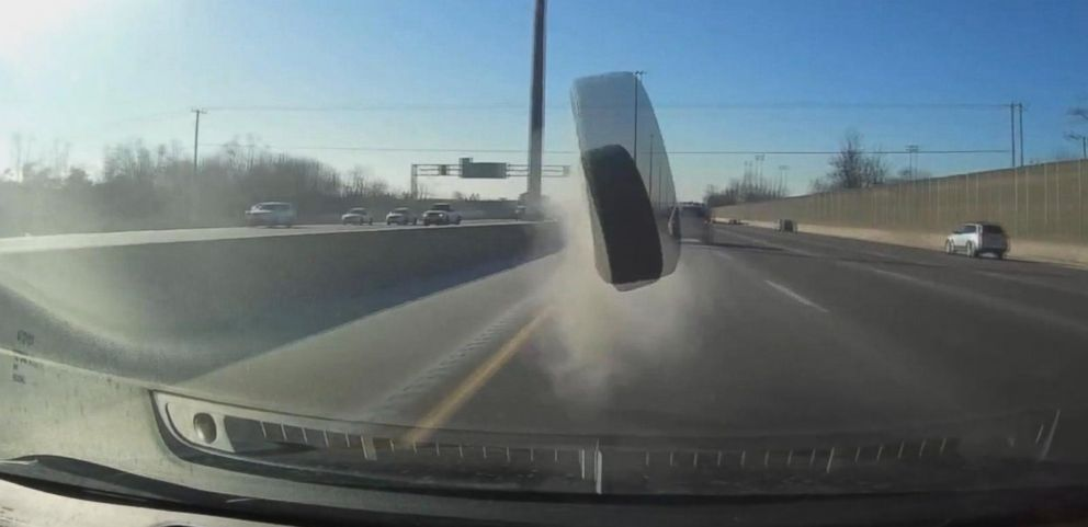 VIDEO: A man in Canada was driving home from work when a loose tire from another vehicle struck and dented his car.