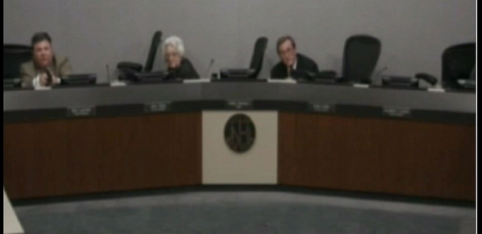 VIDEO: The council members ducked behind their desk following the shooting.