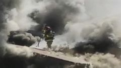 VIDEO: GMA 03/20/15: Firefighters Dangerous Fall Into Fire Caught on Video