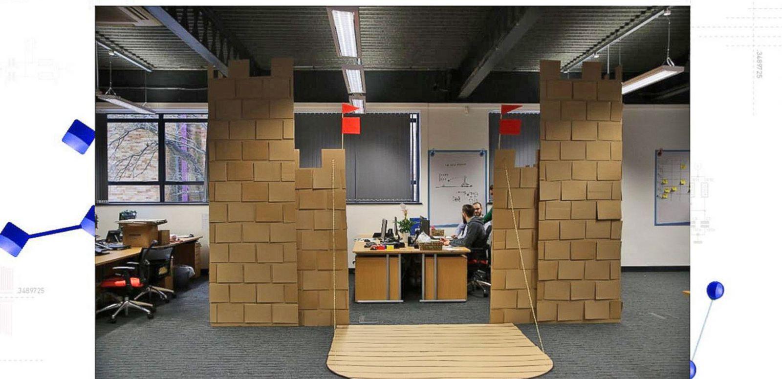video coworkers built a 10 foot tall cardboard castle in office cardboard office