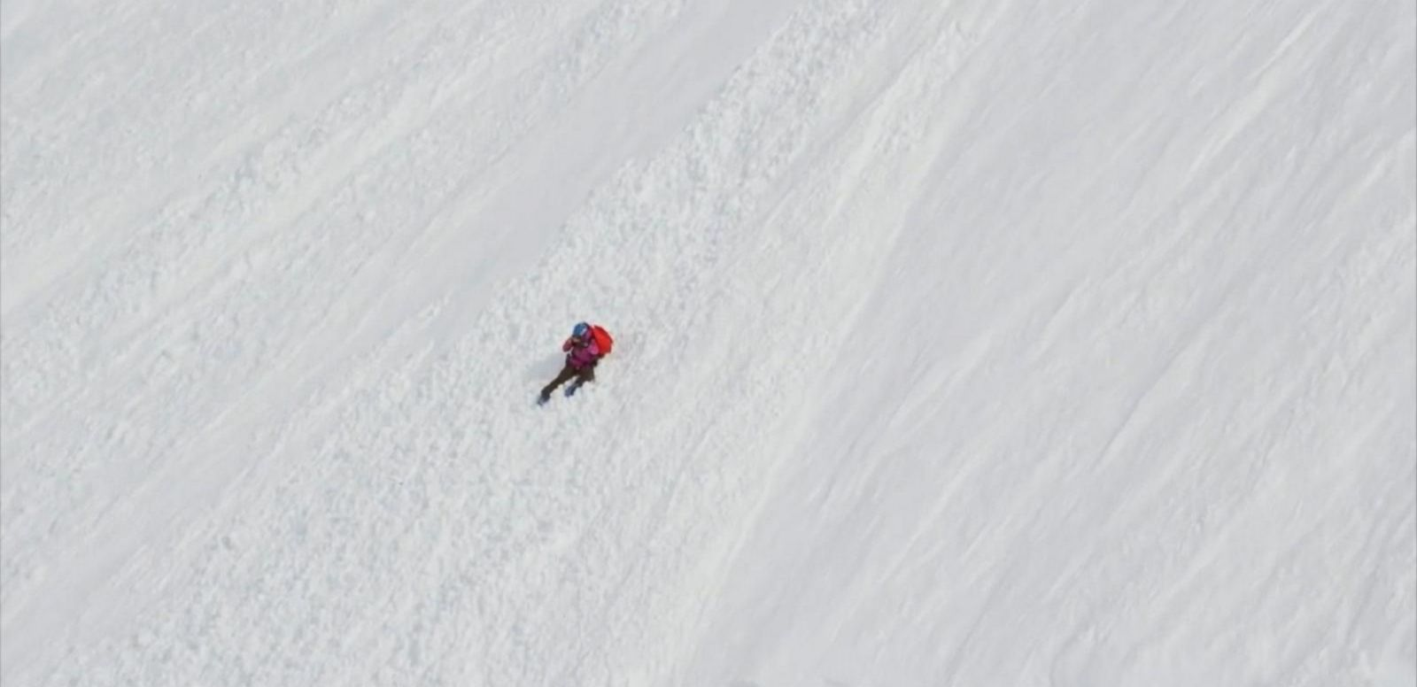 VIDEO: Angel Collinson was skiing in the Neacola Range in Alaska when she flipped onto her back and tumbled down.