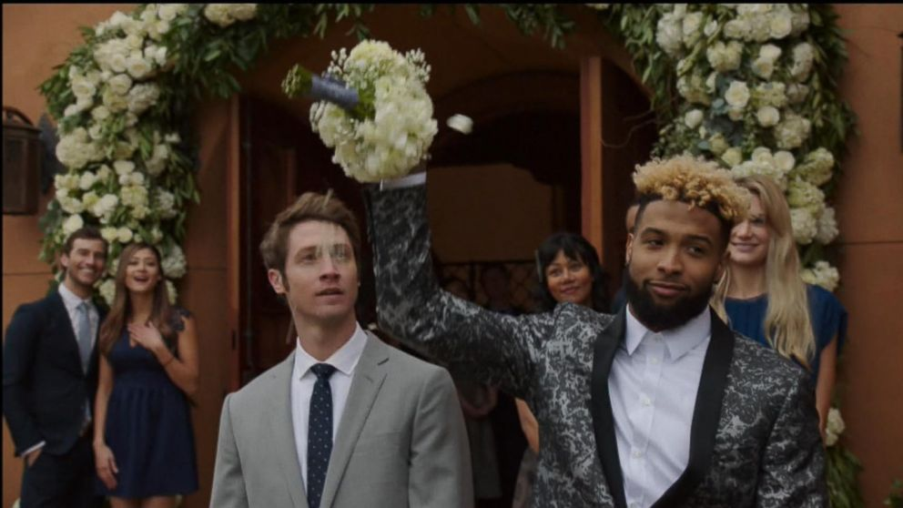 VIDEO: Actress Emily Ratajkowski is a bridesmaid who channels Odell Beckham Jr. to catch the wedding bouquet.