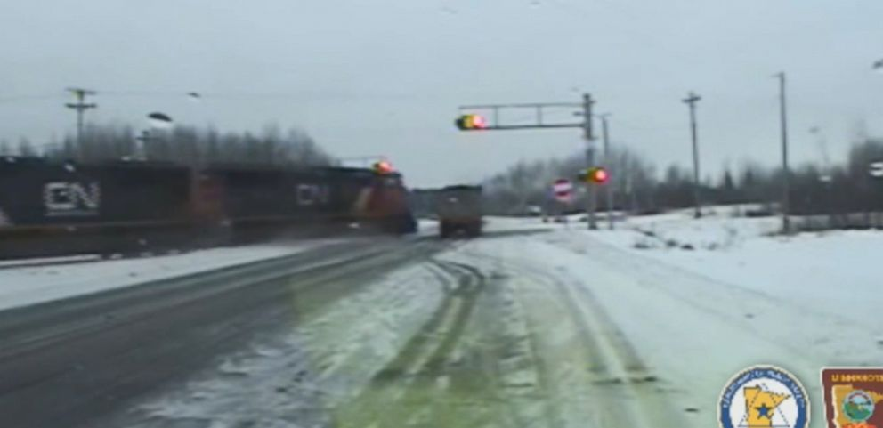 VIDEO: The driver in Minnesota escaped with minor injuries after his semitrailer was hit and pulled a quarter-mile down the tracks.