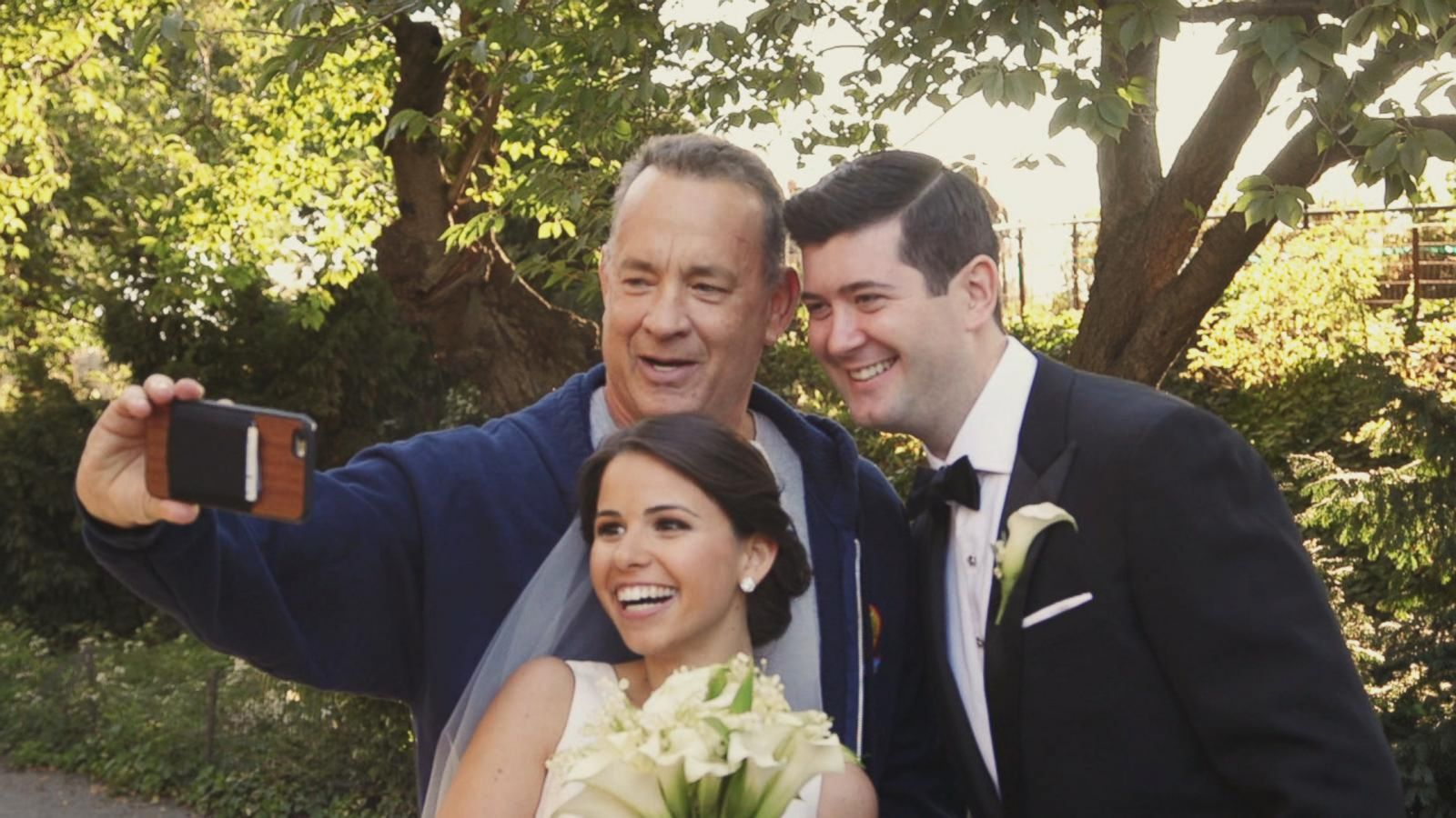 VIDEO: Tom Hanks Crashes Newlyweds' Photo Shoot in Central Park