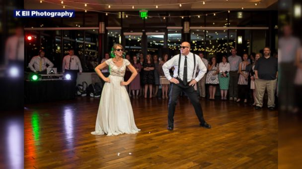 VIDEO: Mikayla Phillips and her dad, Nathan Ellison, surprised guests at Phillips' wedding with a choreographed dance.