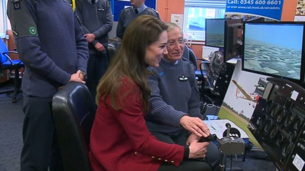 VIDEO: Kate, 35, tested a flight simulator today with Royal Air Force cadets at RAF Whittering in Cambridgeshire, England.