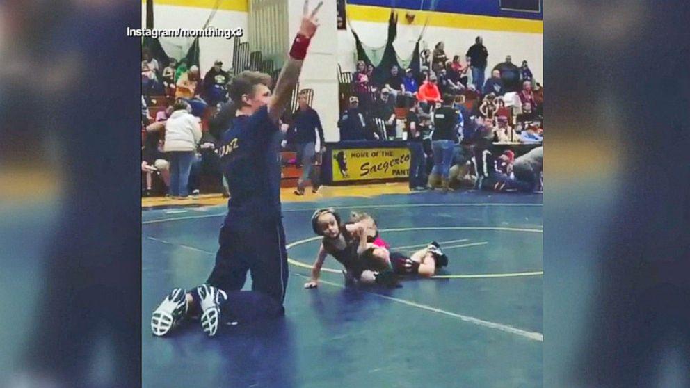VIDEO: Boy runs from girl in toddler wrestling match