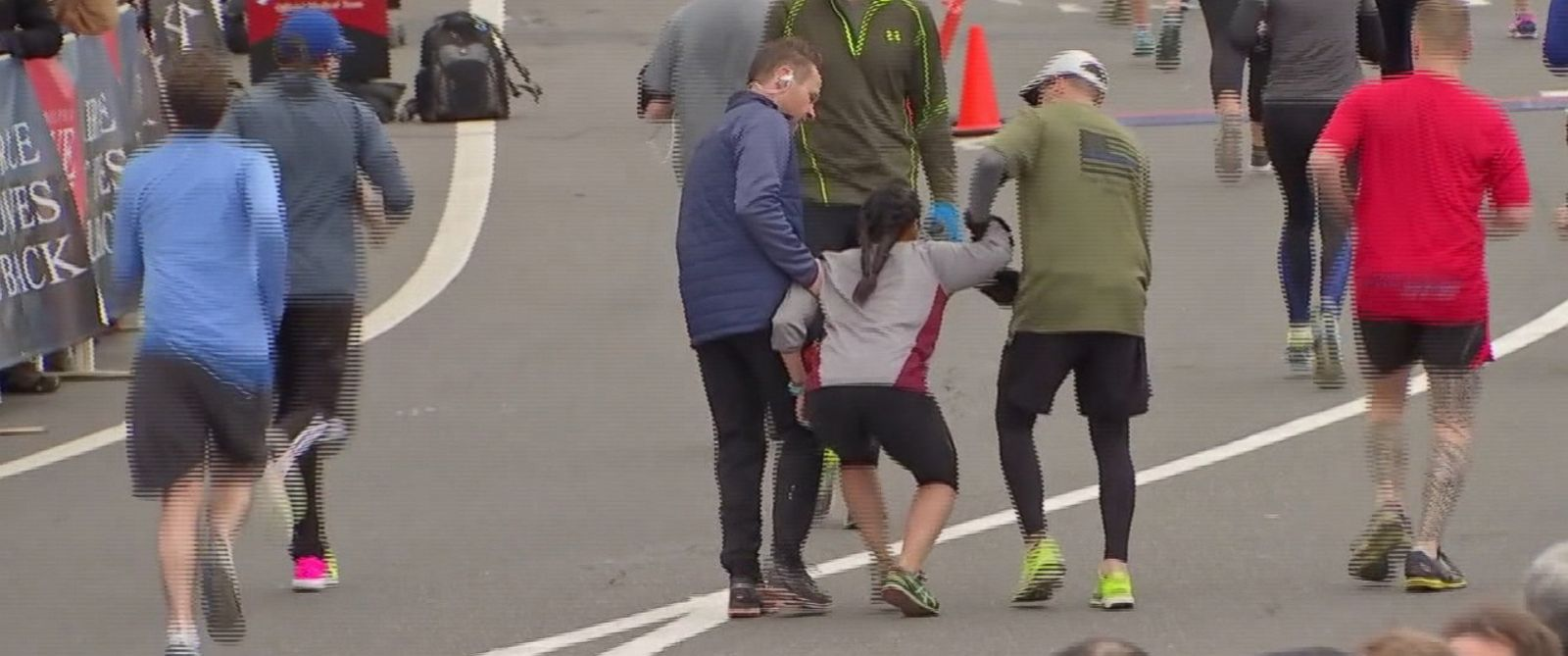 VIDEO: Two runners stopped to help the woman in the Philadelphia Love Run Half Marathon while a third runner carried her to the finish.
