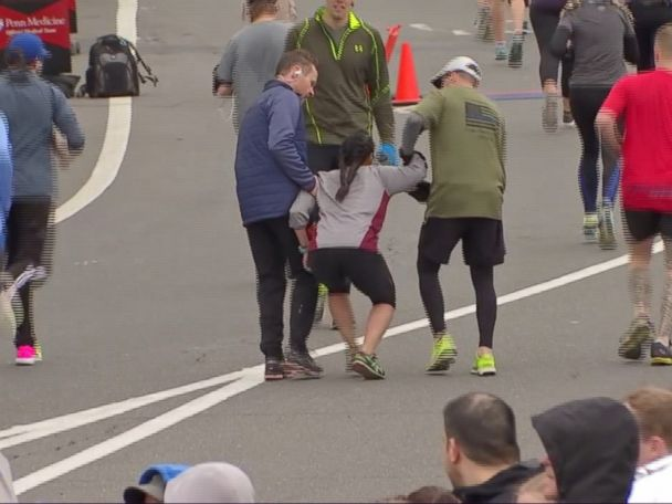 WATCH:  Half-marathon runner carries fatigued woman to finish line
