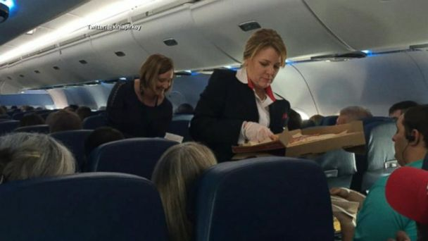 VIDEO: Delta gives out free pizza after cancelling 300 flights