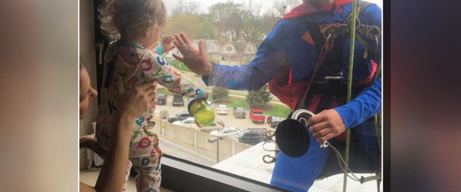 VIDEO: 'Superman' visits tiny cancer patient at hospital window