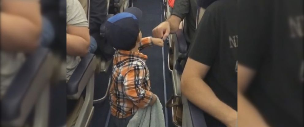 VIDEO: Alya Jakubowiczs son, Guy, was the friendliest passenger on his plane, fist-bumping people as he walked down the aisle.