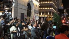 VIDEO: Trump greeted by protestors in return to Trump Tower