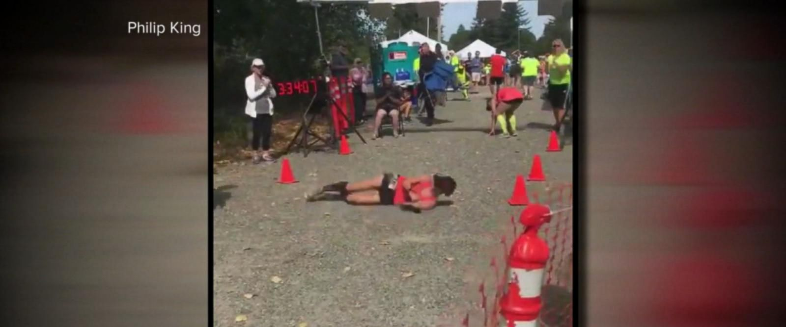 VIDEO: Woman rolls over marathon finish line