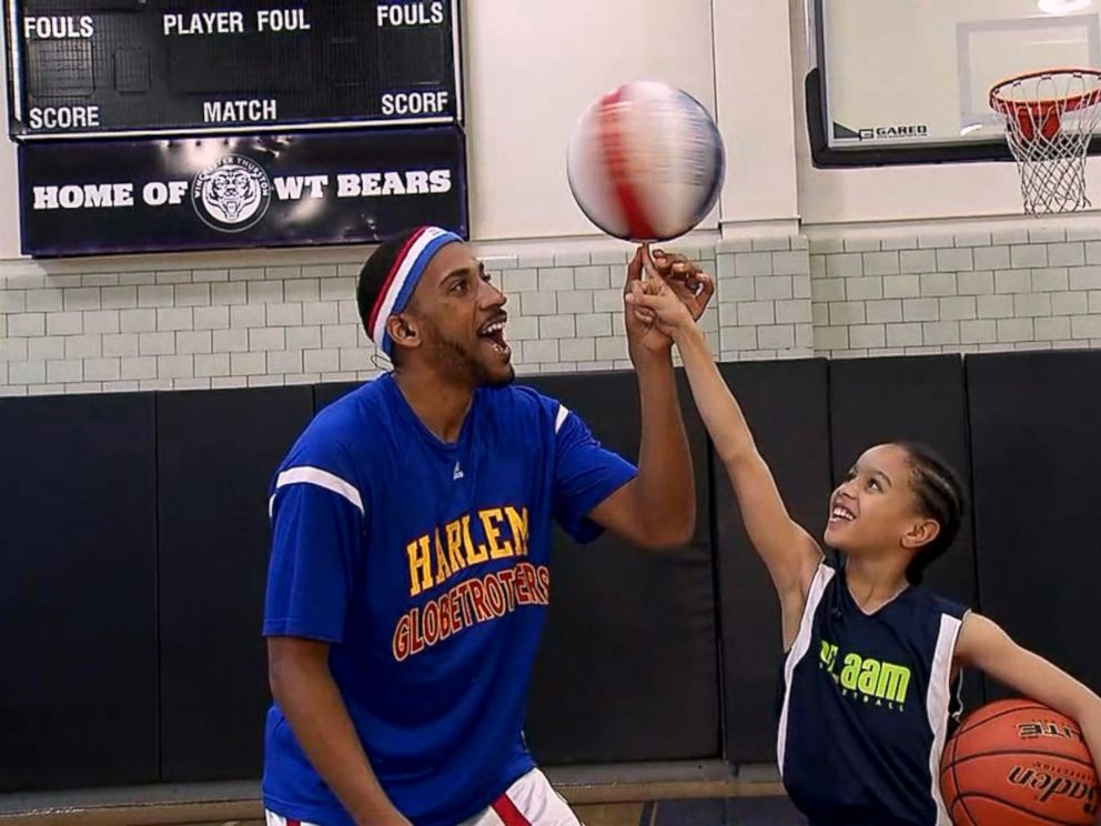 VIDEO: Harlem Globetrotter surprises a 9-year-old basketball star live on GMA