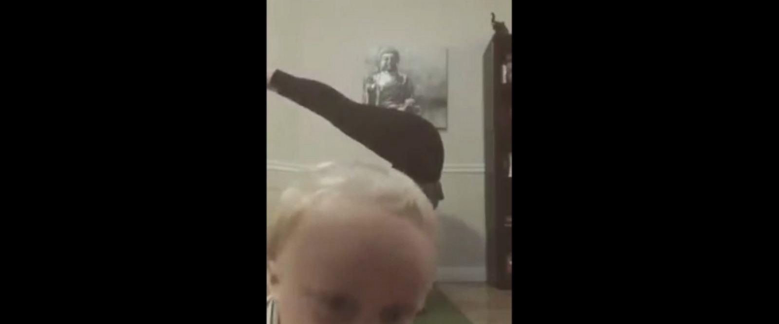 VIDEO: Toddler brilliantly photo bombs his mom's yoga headstand
