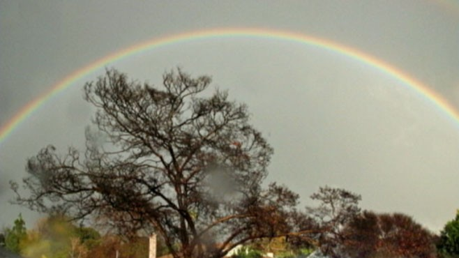 VIDEO: A double rainbow appears over Los Angeles after the area was hit by heavy rains.