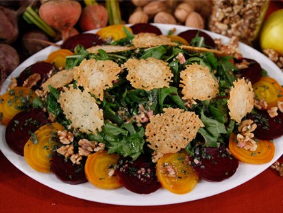 Roasted beet salad with walnut dressing and cheese crisps is shown.