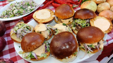 PHOTO:Carla Hall prepares a delicious burger for Labor Day.