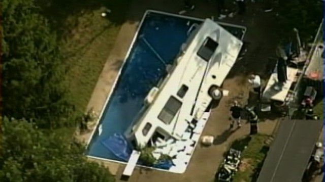 VIDEO: A 30-foot RV crashed through fence into swimming pool after pedal got stuck.