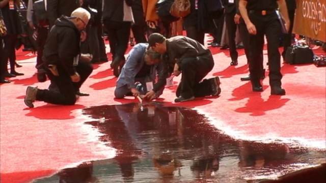VIDEO: Beverly Hills firefighters had to evacuate an area of the red carpet after a pipe reportedly burst.
