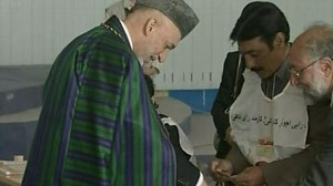 VIDEO: The Afghan president caves to international pressure for a runoff election.