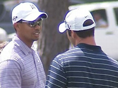 VIDEO: Uniformed and plainclothes security guards surround Tiger Woods at Augusta.