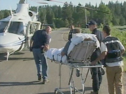 VIDEO: A gurney being wheeled to a MEDVAC helicopter.