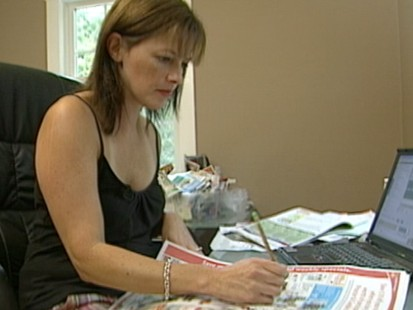 VIDEO: Coupon cutting and special savings can drastically cut the grocery bill.