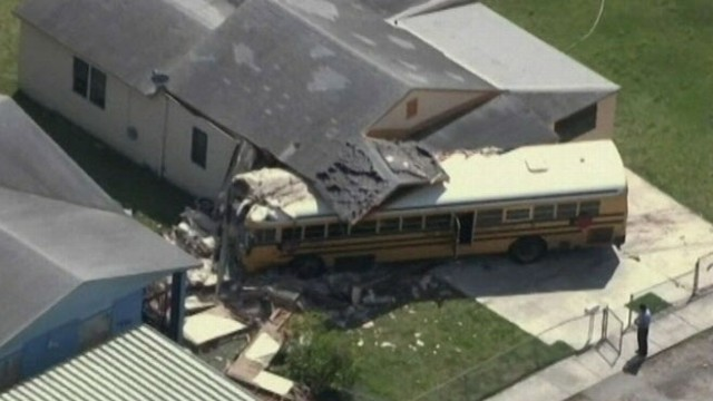 VIDEO: School bus in Miami, Fla., careens into house after colliding with an SUV.