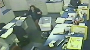 VIDEO: Alleged armed robber hands bullet to store clerk after she prays with him.