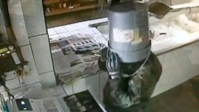 VIDEO: Bucket-Wearing Burglar Caught on Tape