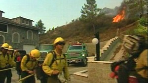VIDEO: Firefighters try to beat back the flames threatening thousands of homes.