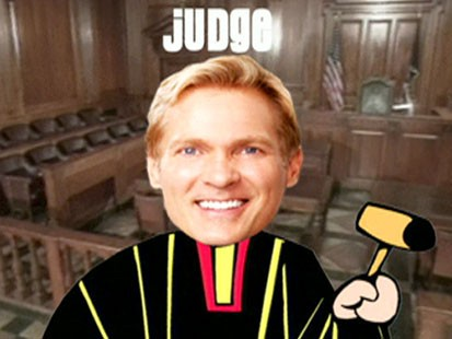 A picture of Sam Champions head on a cartoon judges body.