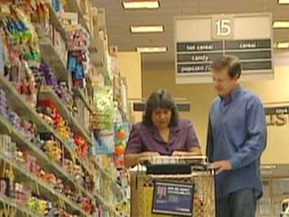 A picture of a couple grocery shoppping.