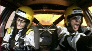 VIDEO: A show lets driving enthusiasts race on a track with a passenger barking at them.