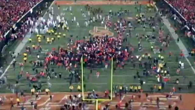 VIDEO: Thousands tore down goalposts after Okla. States win.