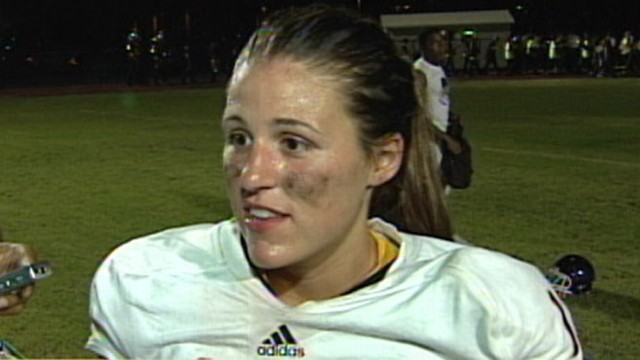 VIDEO: Female breaks gender barrier when she leads her high school football team.