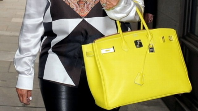 VIDEO: Victoria Beckhams big signature bags cited for trend that results in shoulder problems.