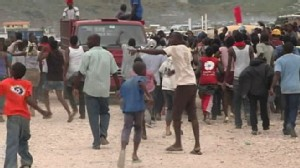 VIDEO: Thousands of refugees from the recent earthquake brace for the powerful storm.